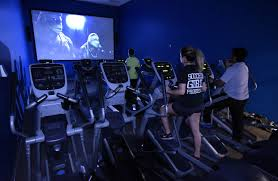 watch movies in theater at home movies at the gym a lure for reluctant exercisers wsj