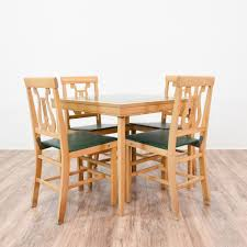 this vintage folding dining set is featured in a solid wood with a