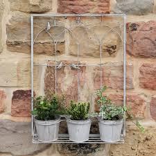 three wall hanging planter pots