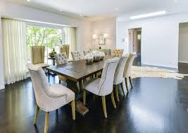 trestle dining table with tufted dining chairs transitional