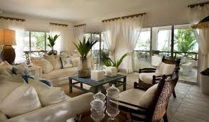 themed living room decor tropical living room decorations with white sofa and wicker chairs