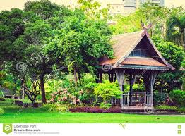 big wooden asian country style pavilion in the beautiful garden