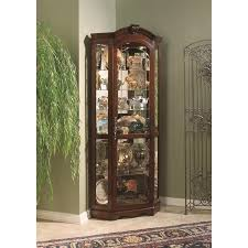 ashley furniture corner curio cabinet pulaski curios corner cabinet in medallion cherry 20671