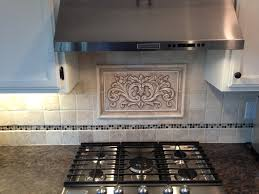 Decorative Kitchen Backsplash Hand Pressed Floral Tiles Installed In Kitchen Backsplash