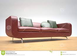 red leather sofa and green cushions royalty free stock image