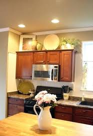 decorating ideas for the top of kitchen cabinets pictures top cabinet decorating ideas upandstunning club