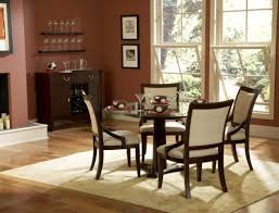 scenic small dining room with fireplace rounded table set for