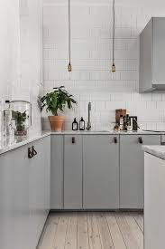 dove grey paint kitchen cabinets a kitchen with dove grey kitchen cabinets and white tile for