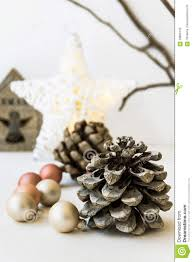 white christmas decoration composition big pine cones scattered