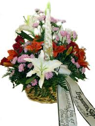 basket arrangements sympathy flower arrangement in a basket with candle and printed