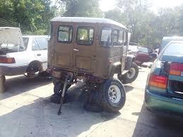 car junkyard michigan rusty junkyard fj land cruiser 7552869260 l