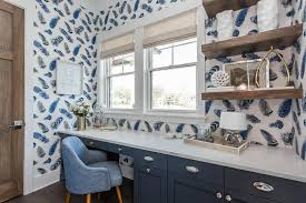 blue home office with salvaged wood floating shelves