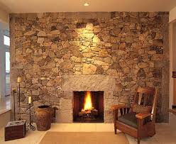 pretty stone fireplace on interior with fresh stack stone