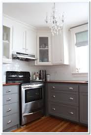 lighting two tone kitchen cabinets and granite countertops with