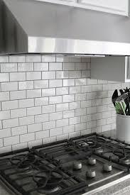 dark gray glass subway tile backsplash floor decoration