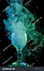 halloween background witch abstract art hookah smoke aquamarine cocktail stock photo