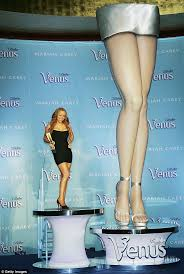 legs of a goddess mariah carey insures her legs and vocal chords for 70million