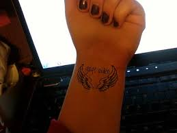 small angel wings tattoo on wrist this would be great for any of