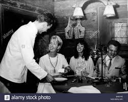 gastronomy tavern scene in a country style inn woman showing