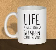 funny coffee mug life is what happens between coffee and