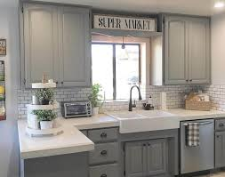 light grey stained kitchen cabinets with white tile backsplash and