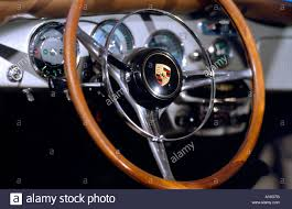 steering wheel and dashboard of vintage porsche stock photo