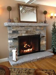 interior stacked stone fireplace surround plus bookcases and