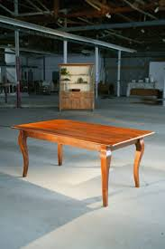 custom dining table with brown cherry with cabriole legs wood