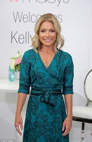 kelly ripa dons teal dress to launch her exclusive collection with