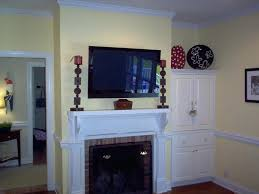 tv wall mount stone fireplace gas with mounted over it lower brick
