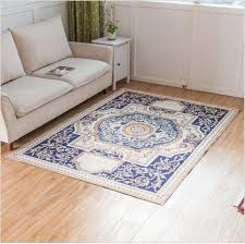 living room layered area rug over carpet in living room with