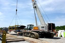 link belt telecrawlers lift pipes at ny power facility crane