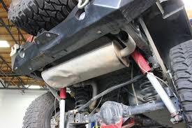 stock jeep suspension gibson exhaust adds power and departure angle to sgt rocker jeep