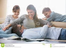 happy family in living room stock photo image 41409816