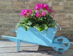 Wooden Wheelbarrow Planter by 10 Diy Garden Flower Projects Thrifty Rebel Vintage
