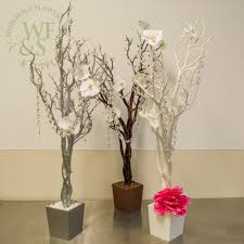 wholesale flowers and supplies manzanita centerpiece tree in white brown and glittered silver