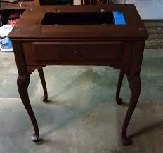 White Sewing Machine Cabinet by Sewing Machine Mavin Stumbled Upon