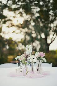 mismatched glass vase centerpieces