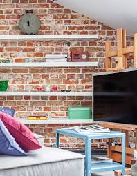 book shelves on brick wall