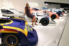 porsche museum and porshe maria sharapova poses at the porsche museum