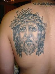 religious jesus with crown on left back shoulder