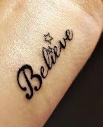 star tattoo design on wrist