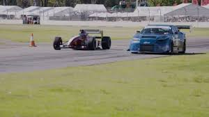 car nissan skyline watch a formula 1 car roll race an r34 nissan skyline gt r the drive