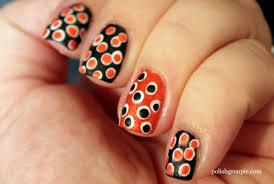 black and orange polka dot halloween background 60 stylish orange and black nail art design ideas