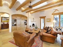 living room with ceiling fan u0026 slate tile floors in santa fe nm