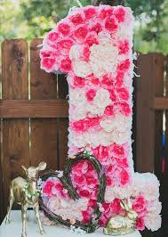 baby girl 1st birthday themes this floral decor for a 1st birthday party for a girl