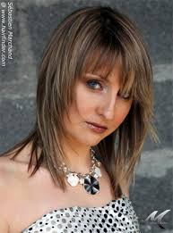 medium length tapered or layered hairstyles for women over 50 feathered shag hairstyles feathered hairstyles for medium length