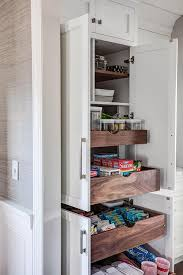 Pantry Cabinet With Pull Out Shelves by Hidden Pantry With Stacked Pull Out Shelves Transitional Kitchen