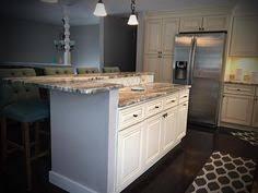 jsi wheaton kitchen cabinets jsi cabinetry s wheaton cabinets with fantasy brown granite