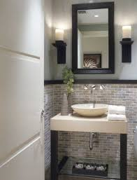 bathrooms featuring brick walls